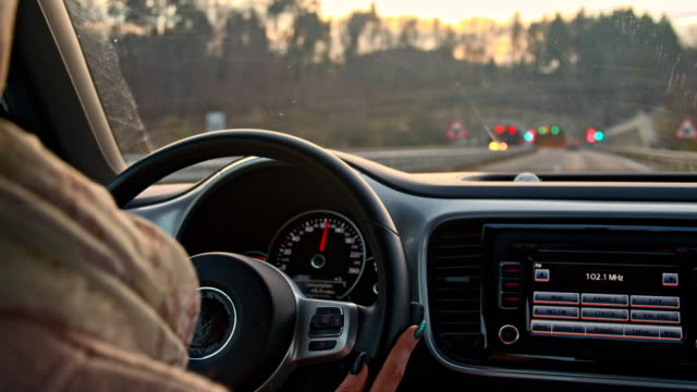 SLO MO Woman's hands holding a steering wheel