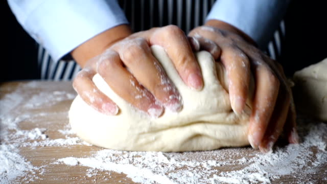 woman's hands kneading dough - kneading stock videos and b-roll footage