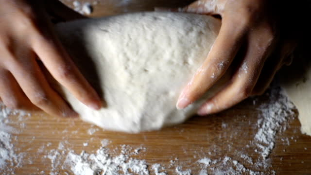 woman's hands kneading dough - proofing baking technique stock videos and b-roll footage
