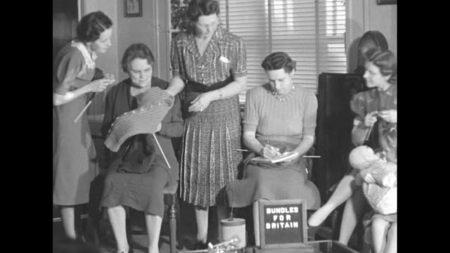 cu womans hands knitting pan to official âbundles for britain pin on womans dress / vs group of various aged women knit inspect knitting sign on... - knitting stock videos & royalty-free footage