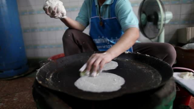 CU Womans hands making spring roll wraps on  hot skillet / Bangkok, Bangkok, Thailand