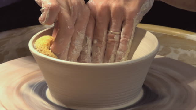 cu zi woman's hands molding clay on wheel / naperville, illinois, usa - one mature woman only stock-videos und b-roll-filmmaterial