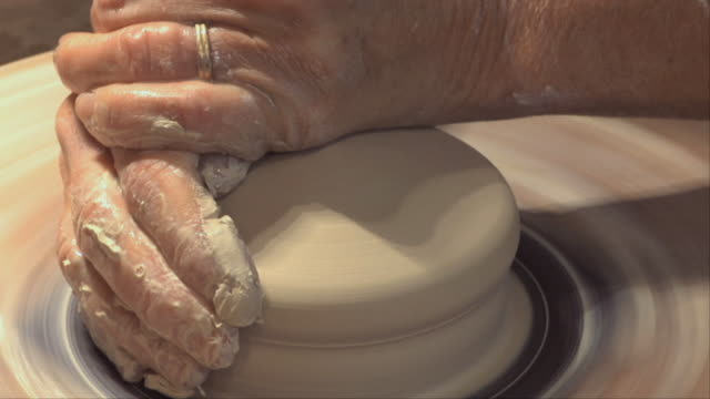 cu woman's hands molding clay on wheel / naperville, illinois, usa - only mature women stock videos & royalty-free footage