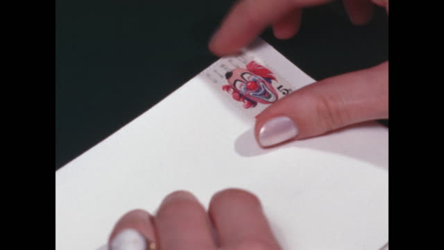 cu woman's hands placing stamps on white envelopes - file clerk stock videos & royalty-free footage