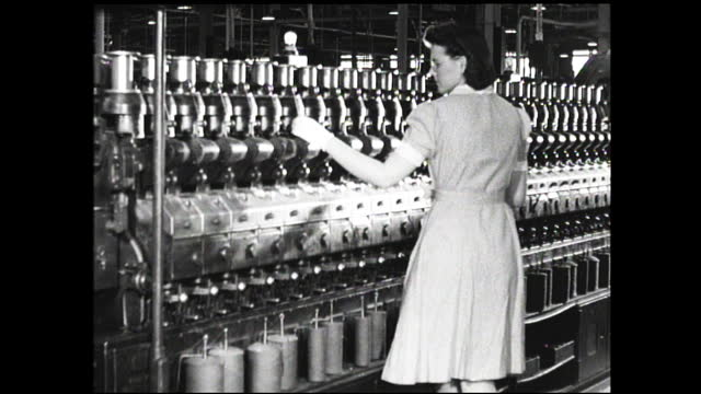 woman's hands running wires into connections; woman with gloves checking wall full of spools of wiring inside factory - 1940 1949 video stock e b–roll