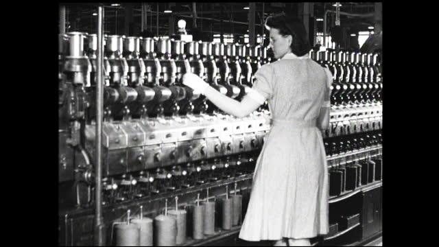 woman's hands running wires into connections; woman with gloves checking wall full of spools of wiring inside factory - 1940 1949 bildbanksvideor och videomaterial från bakom kulisserna