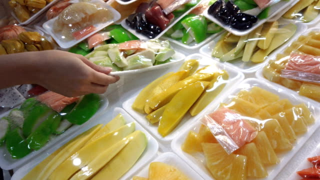 woman's hands take fresh fruits in the plastic container. a woman buying ready to eat fruits - plastic container stock videos and b-roll footage