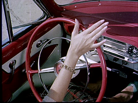 1952 CU Woman's hands turning steering wheel of red 1953 Chevrolet / USA