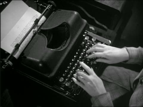 b/w 1943 overhead woman's hands typing on typewriter - typewriter stock videos & royalty-free footage