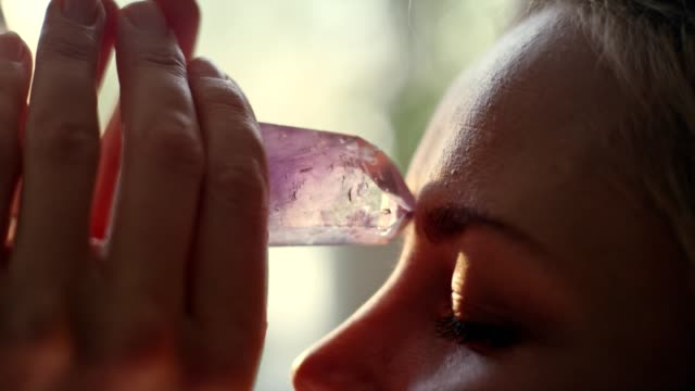 Woman's head with a healing crystal.