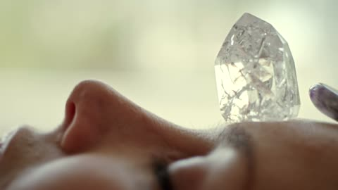 woman's head with a healing crystal. - new age stock videos & royalty-free footage