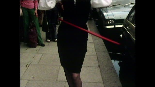 cu of woman's hips using a hula hoop on street; 1974 - waist stock videos & royalty-free footage