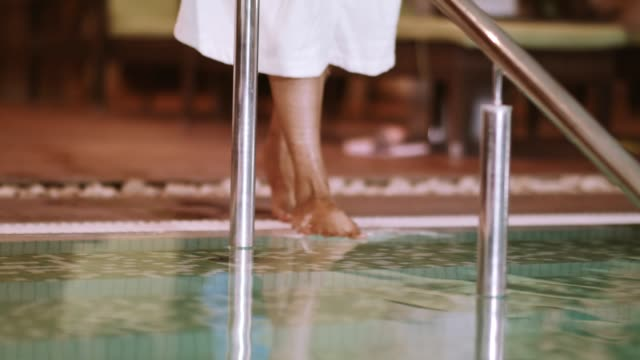 woman's legs barefoot by the poolside - bathrobe stock videos & royalty-free footage
