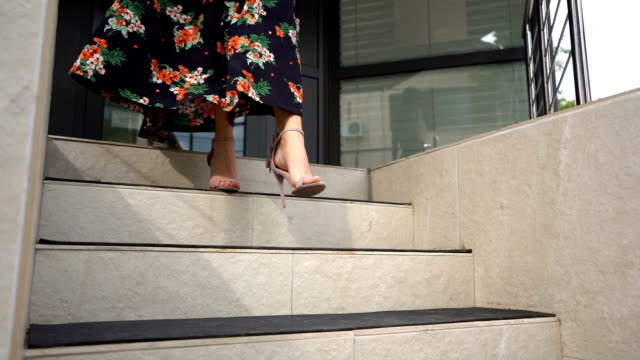 woman's legs stepping down on stairs - high heels stock videos & royalty-free footage