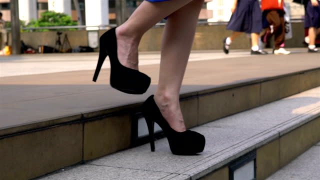 woman's legs stepping down on stairway in city. - human foot stock videos & royalty-free footage