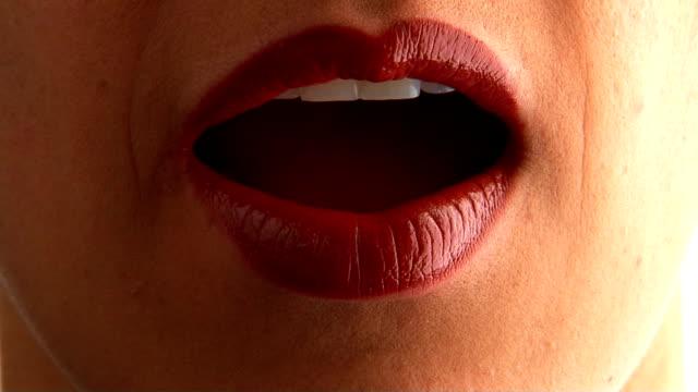 woman's lips - 人間の舌点の映像素材/bロール