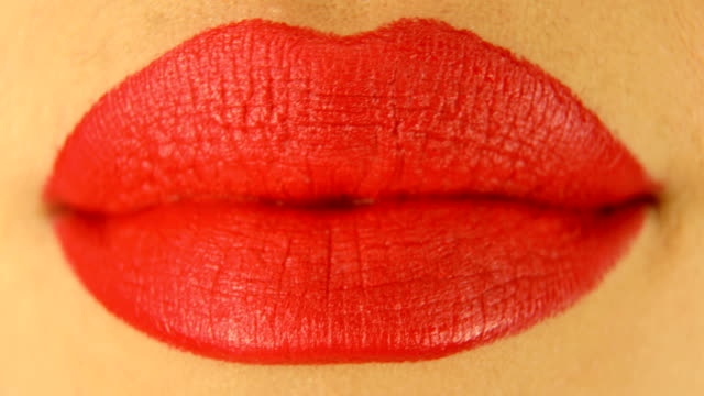 woman's lips with red lipstick and kiss gesture - wet stock videos & royalty-free footage