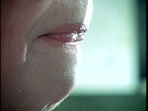 vídeos de stock, filmes e b-roll de 1971 montage woman's mouth and alcohol being poured into glass, los angeles, california, usa, audio   - lambendo