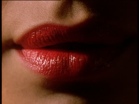 woman's mouth with lipstick - lips stock videos & royalty-free footage