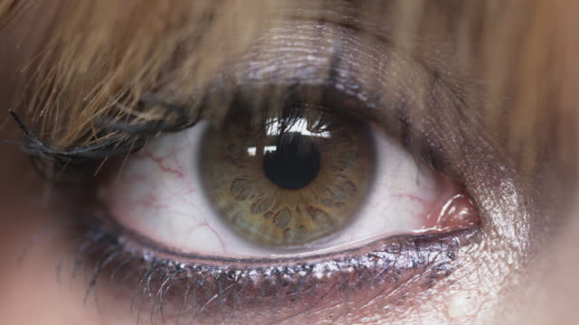 a woman's pupil dilates. - human eye stock videos & royalty-free footage