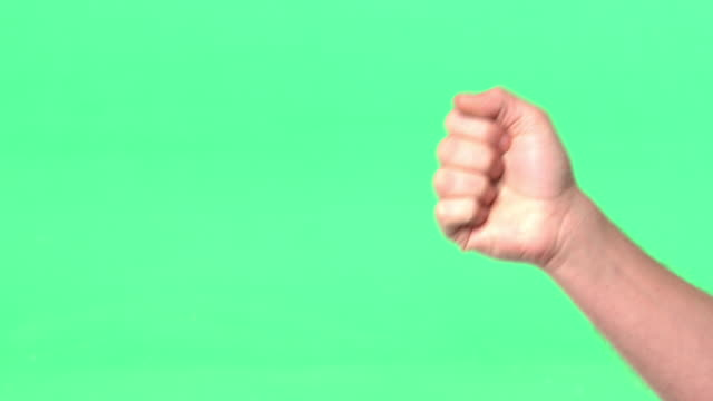 vídeos de stock, filmes e b-roll de woman's right hand performs, 'rock, paper. scissors' - tesoura
