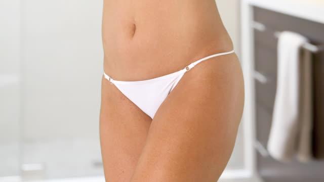 woman's torso with white bikini underwear - torso stock videos & royalty-free footage