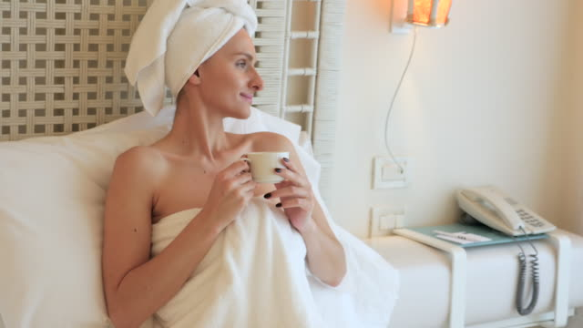 woman's way of relaxing ! - wrapped in a towel stock videos & royalty-free footage