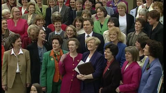 centenary of women's right to vote t07059724 / tony blair mp posing for photograph on steps with women mps conservative mp's clapping as theresa may... - parlamentsmitglied stock-videos und b-roll-filmmaterial