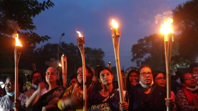 women activists and students attend in a torch procession during the evening an ongoing protest against an alleged gang-rape and brutally torturing... - editorial stock videos & royalty-free footage