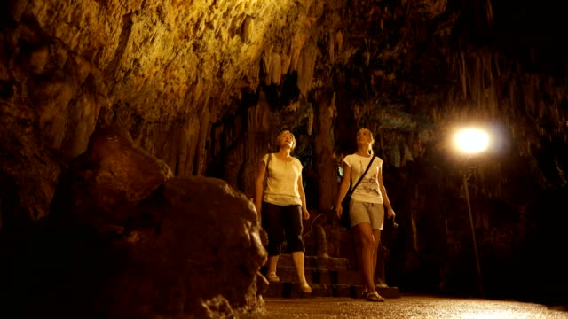 women admiring cave ornaments - karst formation stock videos & royalty-free footage