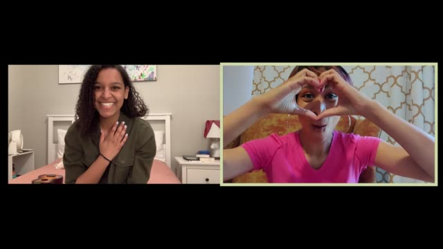 women affectionately share heart hands with each other on their webcams - affectionate stock videos & royalty-free footage