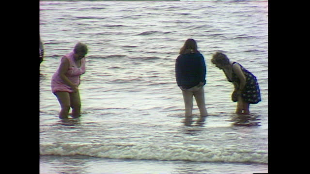 women and children paddle and swim in the sea; 1978 - 1978 stock videos & royalty-free footage