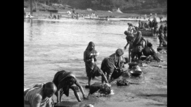 women and children wash clothes on the banks of the godavari river. from a home movie of a car journey from pindi to bombay taken by colonel john... - colonial stock videos & royalty-free footage