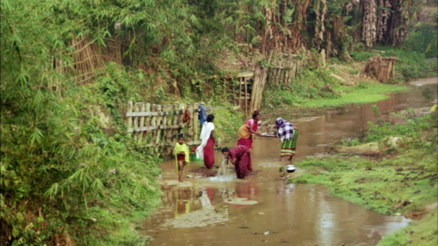 WS, HA, Women and children washing in stream, Bangladesh