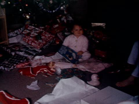 women and little girls open gifts on christmas morning. - 1962 stock-videos und b-roll-filmmaterial