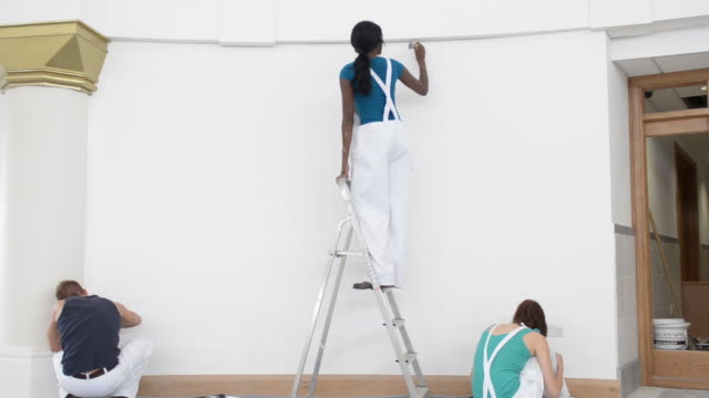 ms women and man painting wall / london, england, united kingdom - house painter stock videos and b-roll footage