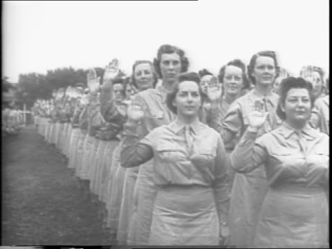 women are assembled in formation at fort des moines iowa / view from colonel oveta culp hobby as she administers the oath of allegiance / closeup of... - anno 1943 video stock e b–roll