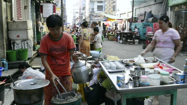 MS Women are cooking in food stall at 19th street / Yangon, Yangon Division, Myanmar