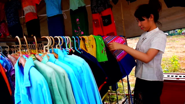 Women are shopping for clothes