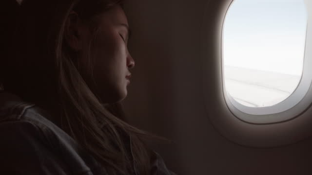 women are sleeping on the plane. - abitacolo video stock e b–roll