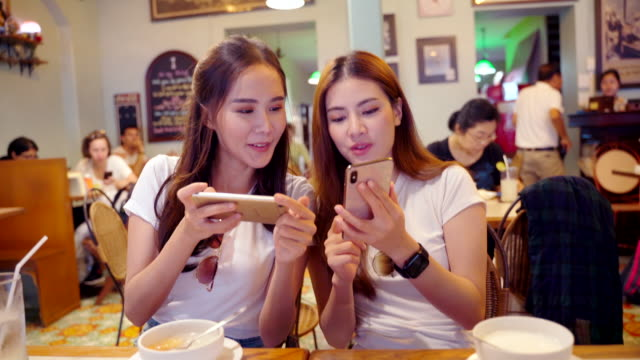 women are viewing the lunch menu of a restaurant near the tourist attraction of thailand. - brochure stock videos & royalty-free footage