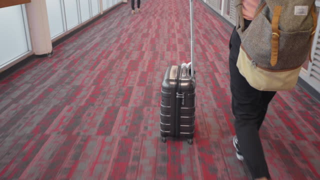 women arriving at the airport - wheeled luggage stock videos and b-roll footage
