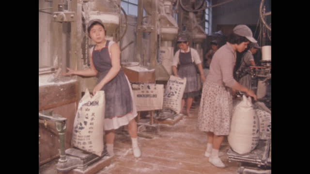 women assemble bags of flour in food processing plant - taipei stock videos & royalty-free footage