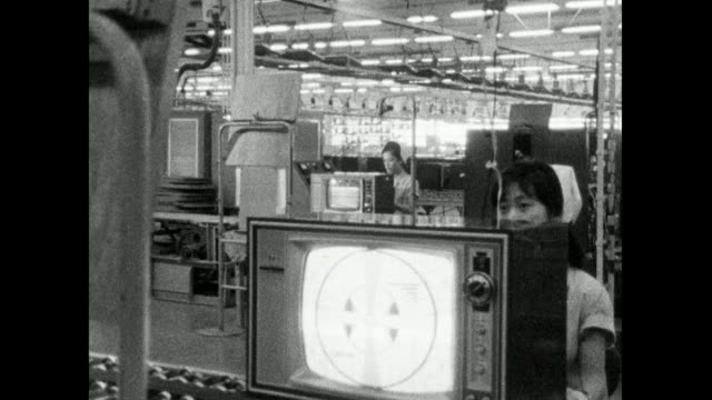 women assemble television sets in japanese factory; 1966 - 科学技術点の映像素材/bロール