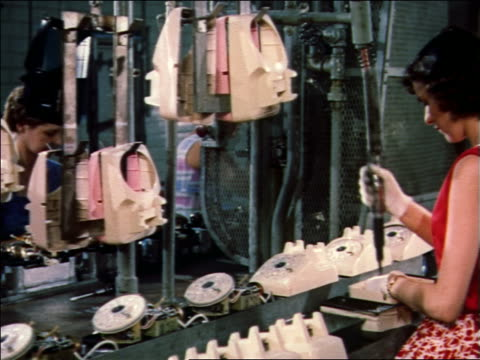 1959 women assembling telephones on assembly line - 1959 stock videos & royalty-free footage
