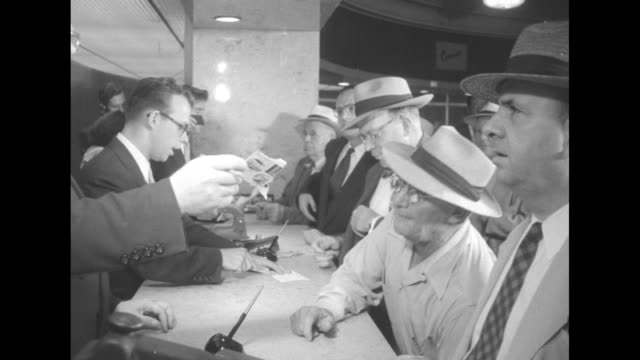 """women at hotel desk wearing """"i like ike"""" straw hats in conrad hilton hotel lobby, sign reads """"in the nation eisenhower the man of the hour"""" desk... - newspaper strike stock videos & royalty-free footage"""