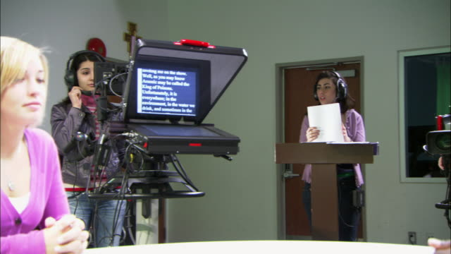 ms pan women at work in television studio, brooklyn, new york city, usa - teleprompter stock videos & royalty-free footage