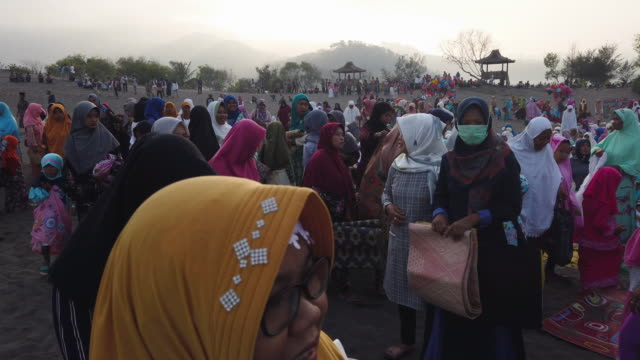 women attend eid alfitr prayer on 'sea of sands' at parangkusumo beach on june 5 2019 in yogyakarta indonesia muslims around the world celebrate eid... - java stock videos & royalty-free footage