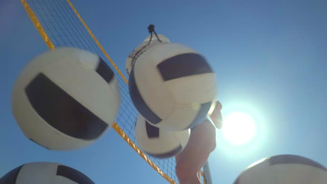pov of women beach volleyball and a player dumping the balls out of a bag. - slow motion - beach bag stock videos and b-roll footage