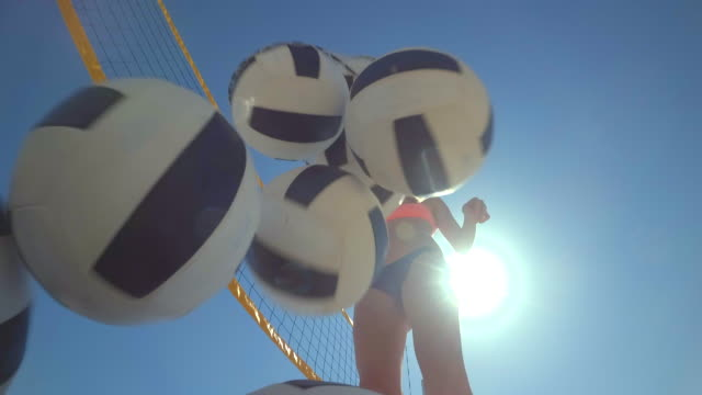 pov of women beach volleyball and a player dumping the balls out of a bag. - beach bag stock videos and b-roll footage